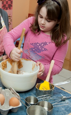 Image of a child baking cookies