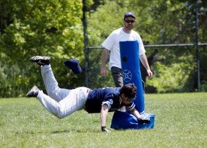Joe Q diving into a base during a beep ball game.