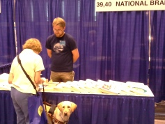 Photo of Tim Turnbull chattin with a customer at the ACB Convention in Columbus.