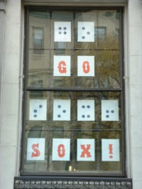 """Go Sox!"" spelled out in print and braille letters on large window at NBP"