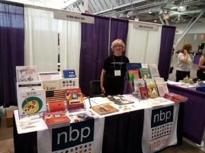 Joanne Sullivan stands behind NBP table