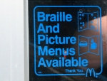 Sign that says Braille and Picture Menus Available