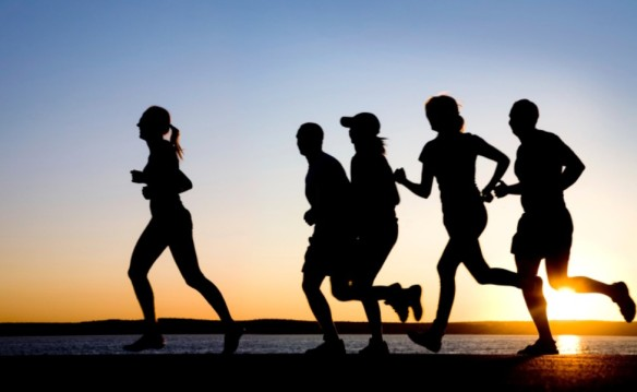 Photo of runners at sunset