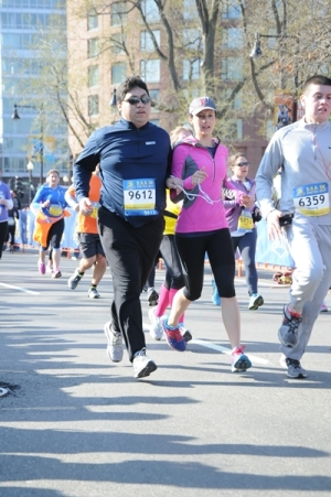 Joe Quintanilla runs with sighted guide, Kara Peters