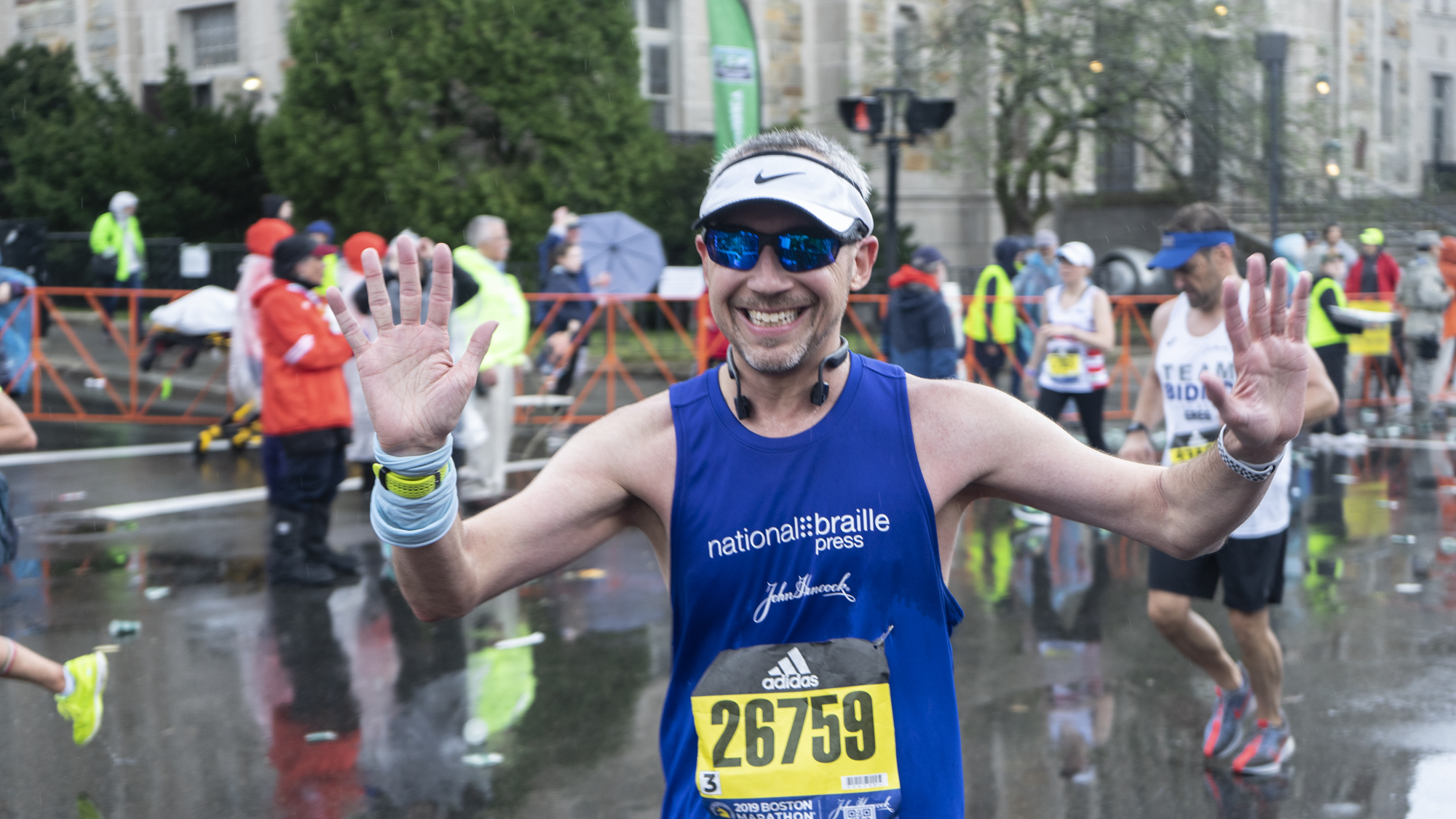 William Flynn smiling for the camera at mile 24 during the 2019 Boston Marathon