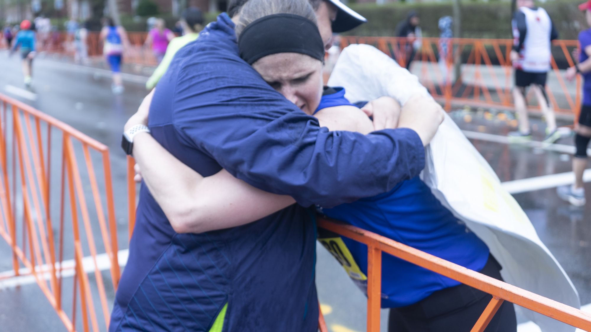 Erin Connors hugging NBP's VP of Development, Joe Quintanilla at mile 24 of the Boston Marathon.